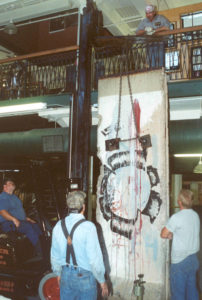 Section of Berlin Wall being lifted into place at Museum of World Treasures.