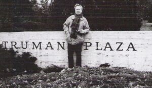 Charles Huffer standing in front of Truman Plaza sign