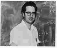 Charles Huffer in front of mathematics chalkboard