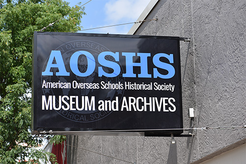 AOSHS Museum and Archives sign on exterior in daytime.