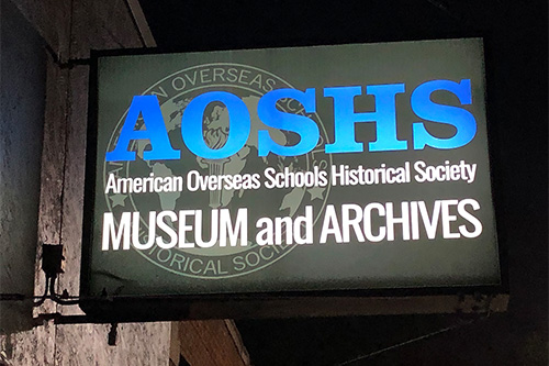 AOSHS museum and archives sign at night
