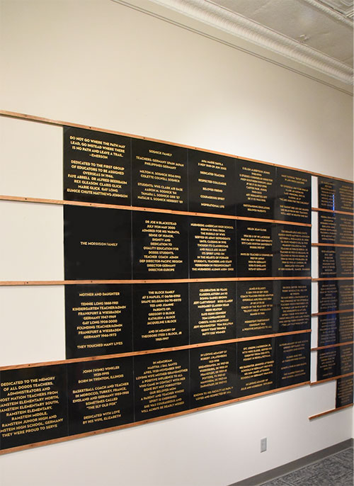 Large, polished granite memorial tiles hanging on wall