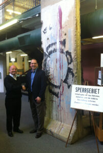 Mike Noller and Carl Fenstermacher with section of the Berlin Wall in the Museum of World Treasures.